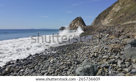 Breezy weather smashing waves at Point Mugu and distant Channel Islands as seen from Thornhill Broom Beach, La Jolla Canyon, Ventura county, CA - stock photo