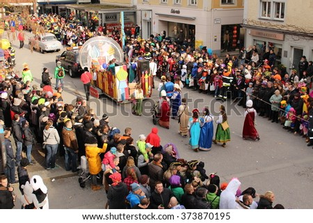 BREGENZ, VORARLBERG, AUSTRIA - FEBRUARY 7, 2016: Annual and traditional carnival parade (Fasching) in front of GWL shopping mall. People dress up with different and funny costumes in this procession. - stock photo