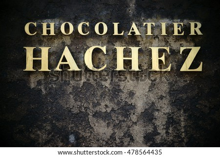 BREMEN, GERMANY - AUGUST 30: The golden nameplate of the Chocolate Factory Hachez & Co on a soot-blackened house facade on August 30, 2016 in Bremen / Chocolate Factory Hachez