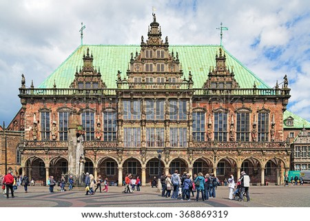 BREMEN, GERMANY - MAY 26, 2015: Town Hall and Roland Statue on the Market Square. In July 2004 the Roland Statue and the Town Hall was listed as a UNESCO World Heritage Site. - stock photo