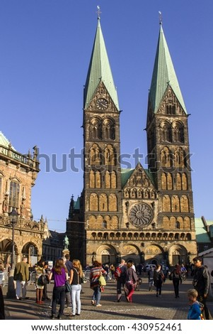 BREMEN, GERMANY - OCTOBER 4, 2014: Tourists near the Bremen Cathedral, on the market square in the center of Bremen,Germany.Bremen Cathedral, dedicated to St. Peter.Bremen,Germany on OCTOBER 4, 2014