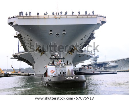 BREMERTON, WA - DECEMBER 9. The USS Nimitz arrives at Puget Sound Naval Shipyard for upgrades and maintenance during its one year stay in Bremerton, WA., USA on December 9, 2010. - stock photo
