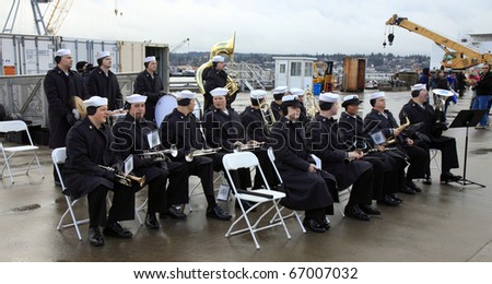 BREMERTON, WA - DECEMBER 9. The USS Nimitz is greeted by the military band at a reception during their arrival for a 1 year stay in Bremerton, WA, on December 9, 2010.