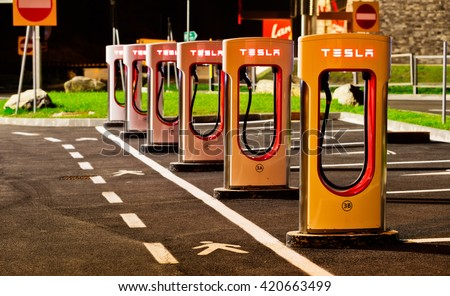 BRENNER, ITALY - MAY 8, 2016: Tesla charging stations are located throughout EU to accommodate owners of the electric car. - stock photo