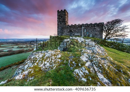 Brentor Church at hill top at sunset, legendary Dartmoor trial in Devon, UK. - stock photo