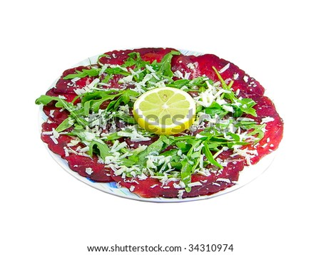 Bresaola with rocket cheese and lemon isolated over white - stock photo