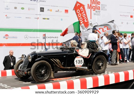 BRESCIA (BS), ITALY - MAY 14: A black Riley Sprite RAC Rally starts the 1000 Miglia classic car race on May 14, 2015 in Brescia (BS). The car was built in 1938. - stock photo