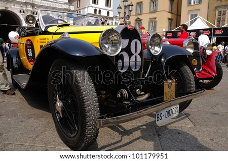 BRESCIA, ITALY - MAY 12 : A 1930 built yellow Bugatti Type 40A waits for the sealing (final compliance check) for 1000 Miglia race on May 12, 2011 in Brescia. - stock photo