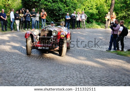 BRESCIA, ITALY - MAY 15: A red Mercedes SSK 710 takes part in the 1000 Miglia classic car race on May 15, 2014 in Brescia. This car was built in 1929 - stock photo