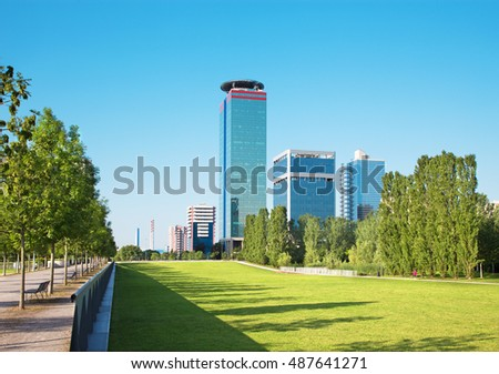Brescia - The Parco Tarello park and modern high buildings.