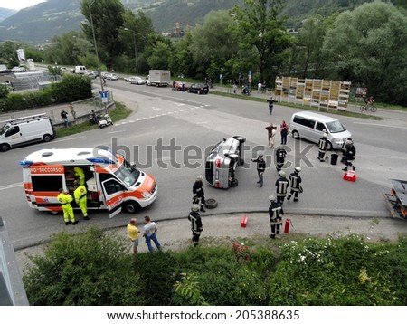 BRESSANONE BRIXEN, ITALY - MAY 20, 2011: car turned upside down after road crash collision with intervention of Firefighters and Paramedics in Bressanone Brixen, on May 20, 2011 - stock photo