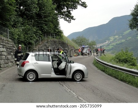 BRESSANONE BRIXEN, ITALY - MAY 2, 2011: Emergency after road crash collision with intervention of Firefighters and Paramedics in Bressanone Brixen, on May 2, 2011 - stock photo