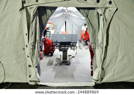 BRESSANONE, ITALY - NOVEMBER 16, 2014: Empty operating room hospital field tent for the first AID. Camp room for the rescue of injured people after flood on November 16, 2014 - stock photo