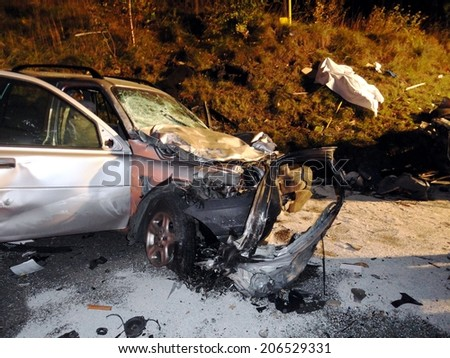 BRESSANONE, ITALY - OCTOBER 12, 2012: Car crash accident with deadly motorist in frontal collision between two cars on the road. Paramedics and firefighters at work in Bressanone on October, 12, 2012