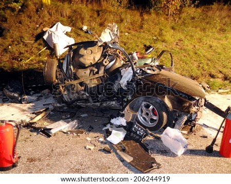BRESSANONE, ITALY - OCTOBER 12, 2012: Terrible car crash accident with deadly motorist after a frontal collision between two cars on the road in Bressanone on October, 12, 2012 - stock photo