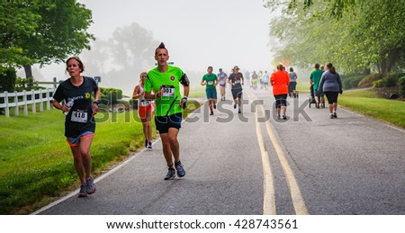 BREVARD, NC-MAY 28, 2016 - Mourning mist surrounded runners in the White Squirrel Race in Brevard, NC 2016.  Race is sponsored by Rotary Club of Brevard, NC - stock photo