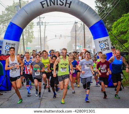 BREVARD, NC-MAY 28, 2016 - White Squirrel 5K Race start with over 350 runners in Brevard, NC 2016 - stock photo