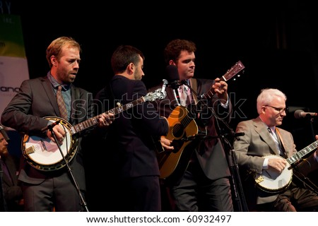 BREVARD, NC - SEPT. 11: The Steep Canyon Rangers perform with surprise guest, comedian Steve Martin (far right) at the bluegrass Mountain Song Festival  on Sept. 11, 2010 in Brevard, NC. - stock photo