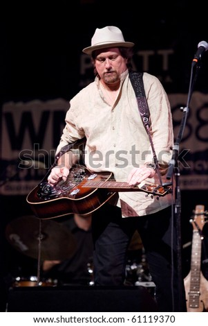 BREVARD, NC, USA - SEPTEMBER 11: Drobo master and Grammy Award winner, Jerry Douglass, performs at the bluegrass Mountain Song Festival in Brevard, NC on Sept 11, 2010 - stock photo