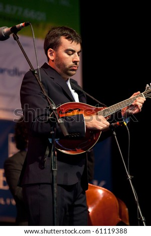 BREVARD, NC, USA - SEPTEMBER 11: Mandolin specialist, Mike Guggino, of the Steep Canyon Rangers, performs at the bluegrass Mountain Song Festival in Brevard, NC on Sept 11, 2010 - stock photo