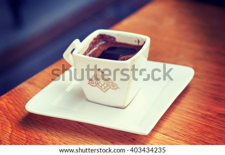 Brewed Turkish coffee on a table at restaurant - stock photo