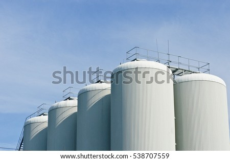 brewery tanks blue sky big containers beer production industry