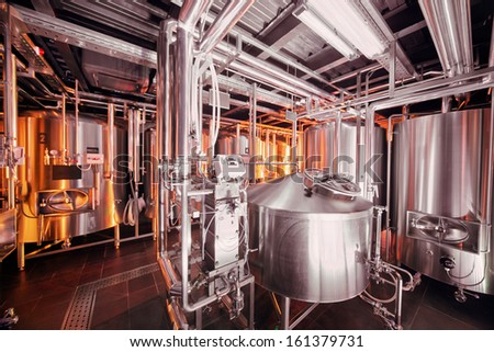 Brewing equipment at microbrewery - stock photo