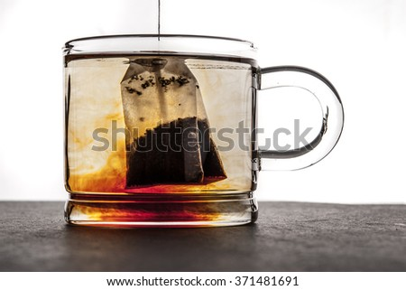 Brewing tea in the transparent cup