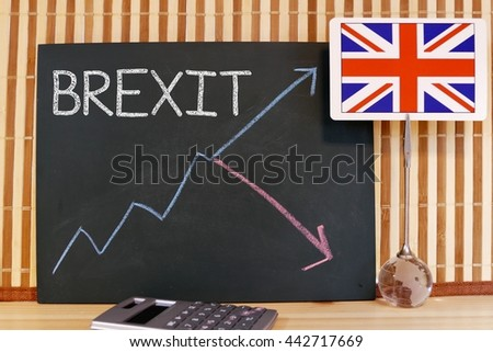 Brexit - a message and graph goes up and down on chalkboard/ blackboard to show the concept about where the economics / currency will go after leaving EU - stock photo