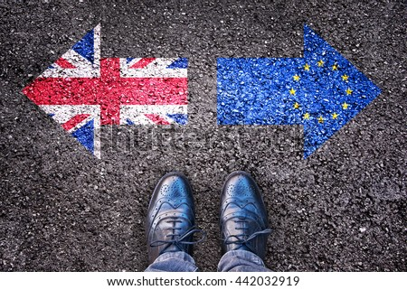 Brexit, flags of the United Kingdom and the European Union on asphalt road with legs - stock photo