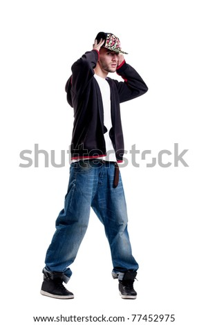 breykdanser cute in a cap and baggy jeans poses for the camera - stock photo