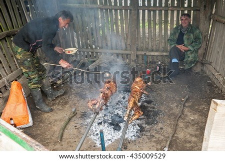Brezovica, Serbia - May 12, 2016: Baking lambs on the spit in a mountain hut