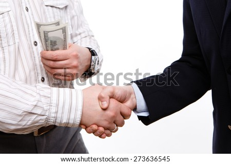 bribe agreement. close hands with money. pay salaries, to give money, dollars, close - stock photo