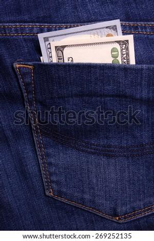 Bribe in jean's pocket. One hundred dollars banknote - stock photo
