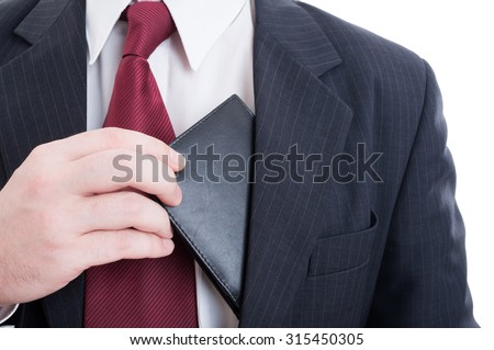 Bribe or bribery concept with leather wallet from inside elegant suit jacket