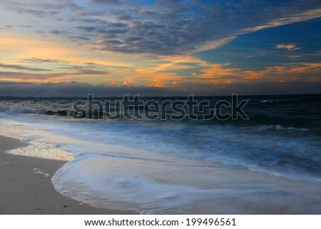 bribie island beach with foam foreground sunrise brisbane queensland - stock photo
