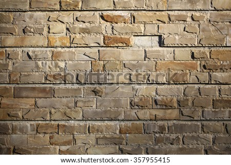 Brick abandoned empty cracked stone wall with brown and gray square bricks structured background wallpaper rugged decoration texture copyspace, horizontal picture - stock photo