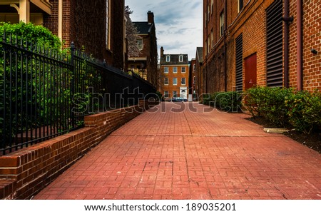 Brick alley and houses in Fells Point, Baltimore, Maryland. - stock photo