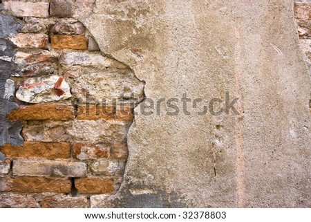 Brick and cement wall - stock photo