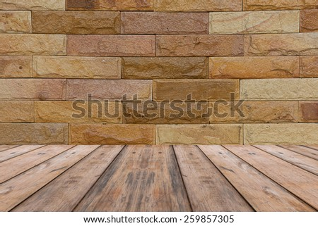 brick and stone wall and wood floor - stock photo