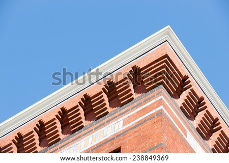 Brick architectural detail exterior wall under roof line. - stock photo