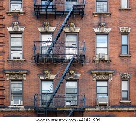 Brick building facade in New York City, USA - stock photo