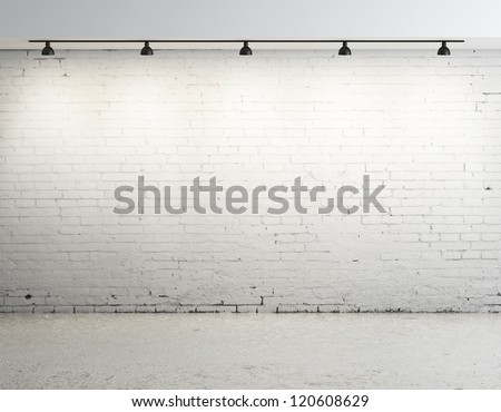 brick concrete room with ceiling lamp - stock photo