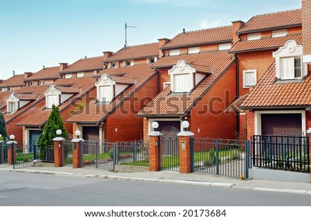 Brick condominium building in the morning - stock photo