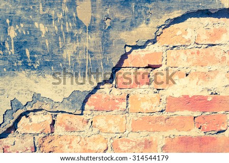 Brick cracked old weathered wall with an old plaster as a background - stock photo