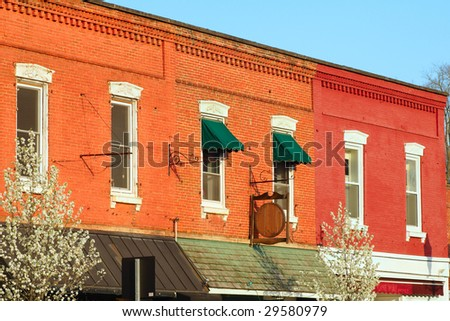 Brick facades of varying colors in downtown Chagrin Falls, Ohio - stock photo