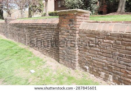 Brick fence - stock photo