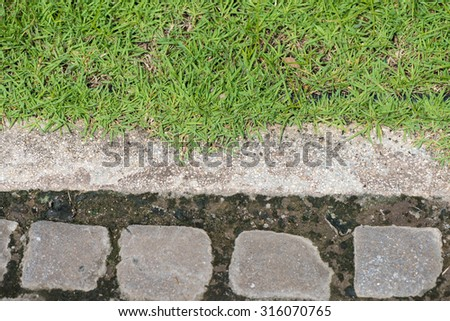 brick floor and green grass