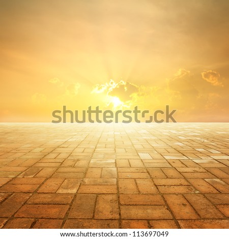 Brick floor and Sunset for background - stock photo