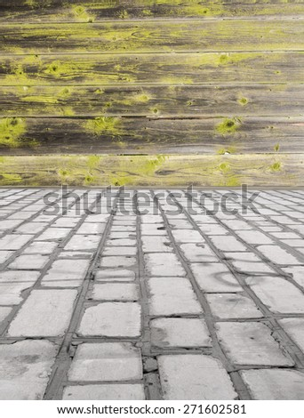 brick floor with a wooden wall